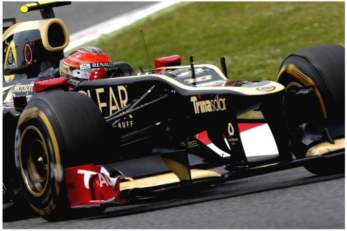 Photo: Romain Grosjean - Lotus F1 Team - Lotus E20 - Renault